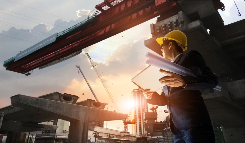 construction engineer manager supervising progress bts station tablet with blueprint hands 1024x597 - 5 Ways ERP Software Can Leverage Non-office Workers' Life